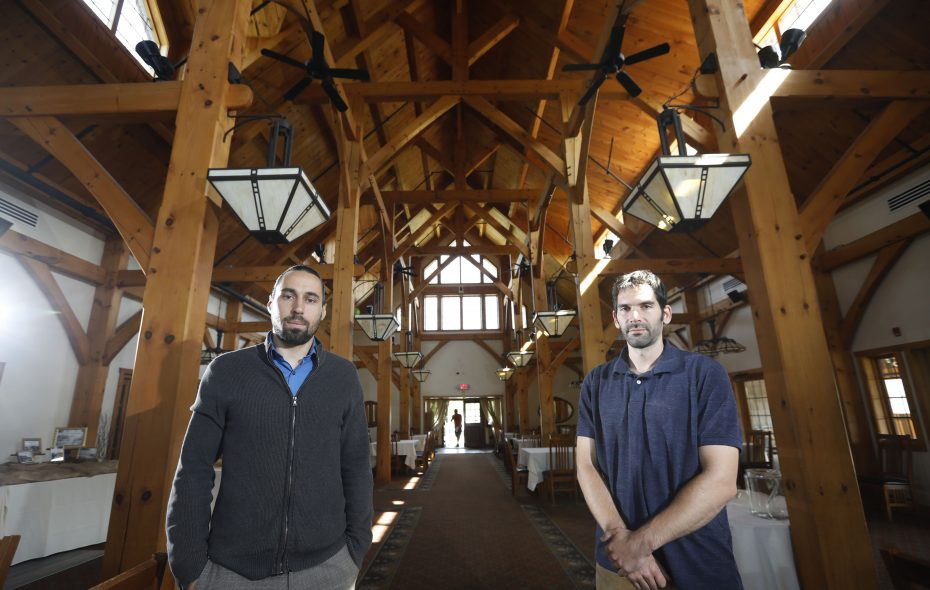 "Clinton Holcomb, left, and Lucas James, the owners of Arrowhead Golf Club, stand in the club's Timberlodge banquet facility, which is hosting a ""Romance at Arrowhead"" dinner on Valentine's Day. (Derek Gee/Buffalo News)"