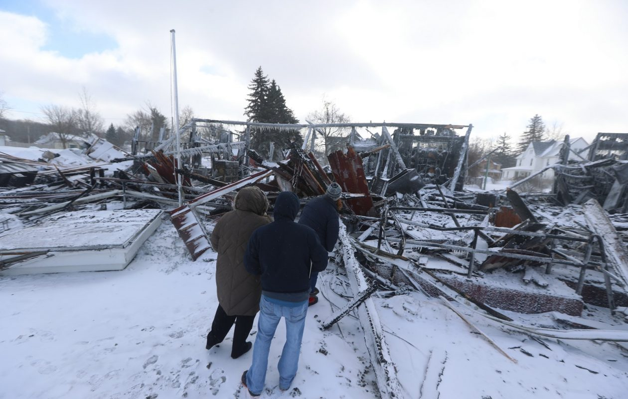 Barker officials look over the remains of their Village Hall and Public Library Jan. 21, 2019, after the shared building was destroyed by fire. (John Hickey/Buffalo News)