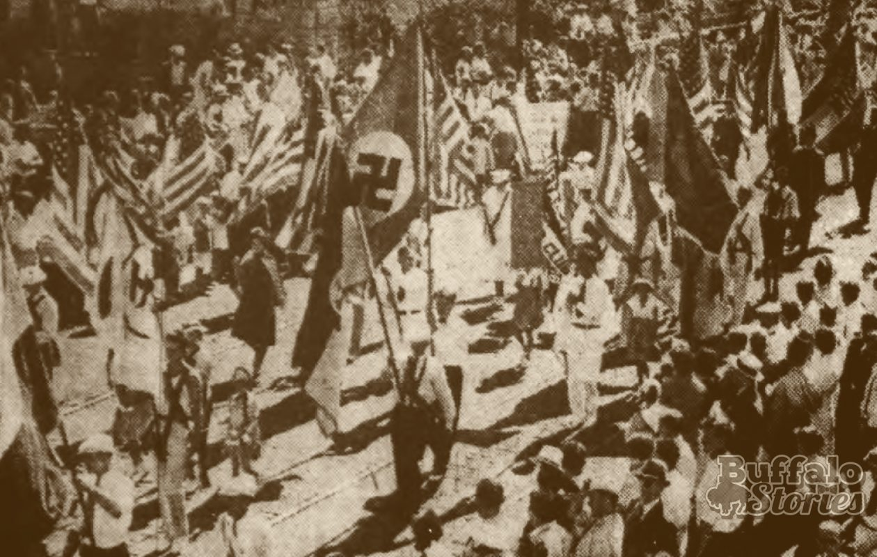 Nazi Swastika flags parade among American flags in  a German Day celebration in Genesee  (now Schiller) Park in 1938.