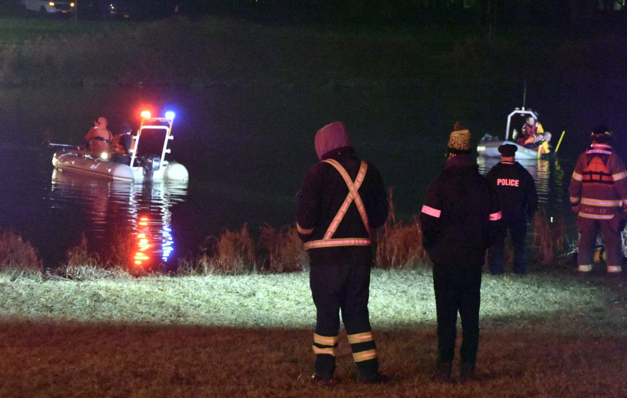 Rescue teams investigate a vehicle that sunk in the Erie Canal near North Tonawanda. (Larry Kensinger/Special to The News)