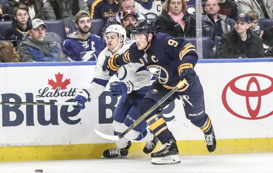 Tampa Bay center Yanni Gourde (37) is called for holding against Buffalo center Jack Eichel (9) in the first period at Key Bank Center in Buffalo, NY on Saturday, Jan. 12, 2019.  (James P. McCoy/Buffalo News)