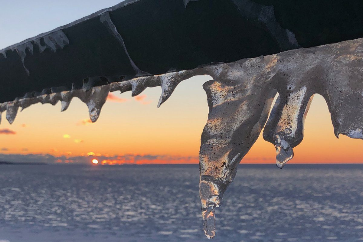 Ice formed on a railing overlooking Lake Erie on Monday in Athol Springs. (T.J. Pignataro/Buffalo News)