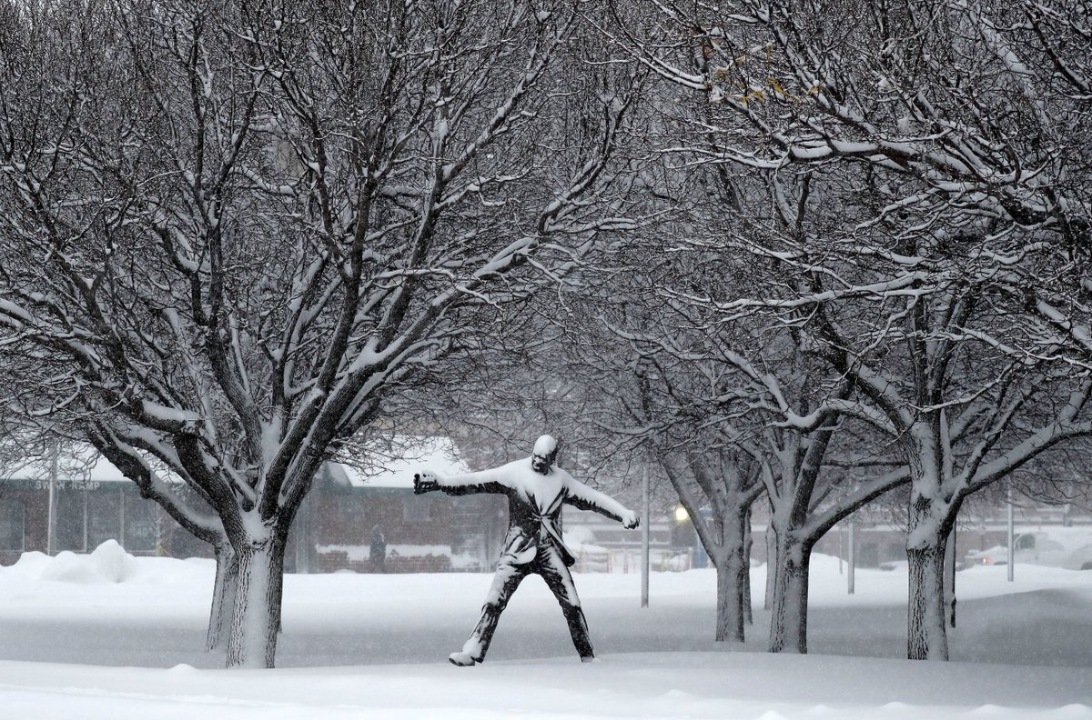 The Jimmy Griffin statue covered in snow Wednesday outside of Sahlen Field in Buffalo. (Mark Mulville/Buffalo News)