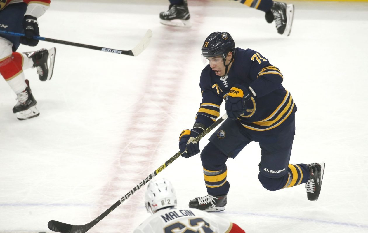 Evan Rodrigues, who took over as the top-line center for Jack Eichel, moves the puck up the ice (Robert Kirkham/Buffalo News)>