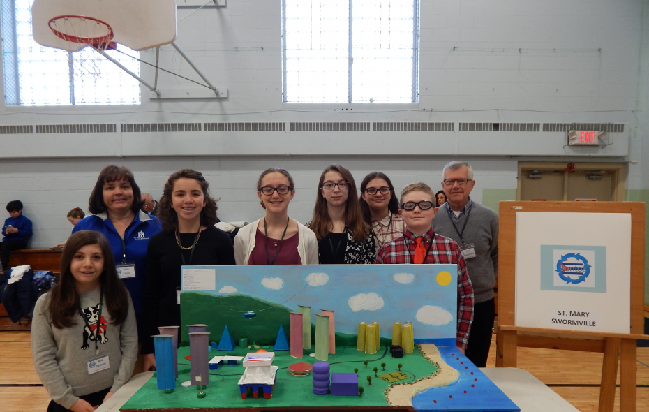 The winning Mill Middle School Future Cities team is comprised of, from left, Ada Bastedo, team mentor Julie Leong, Mia Gilham, Mary Quinn, Jioia D'Andrea Mucciarelli, Maryanna Daigler, David Hatcher, and team engineer Paul Kluczynski. It also includes Alex Kania and Lauren Zwirecki, who are not pictured.