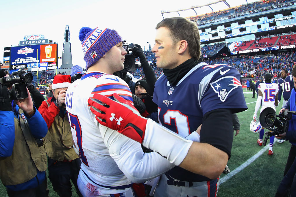 Josh Allen and Tom Brady meet on the field after the New England Patriots defeated the Buffalo Bills 24-12 at Gillette Stadium on Dec. 23, 2018, in Foxborough, Mass. (Maddie Meyer/Getty Images)