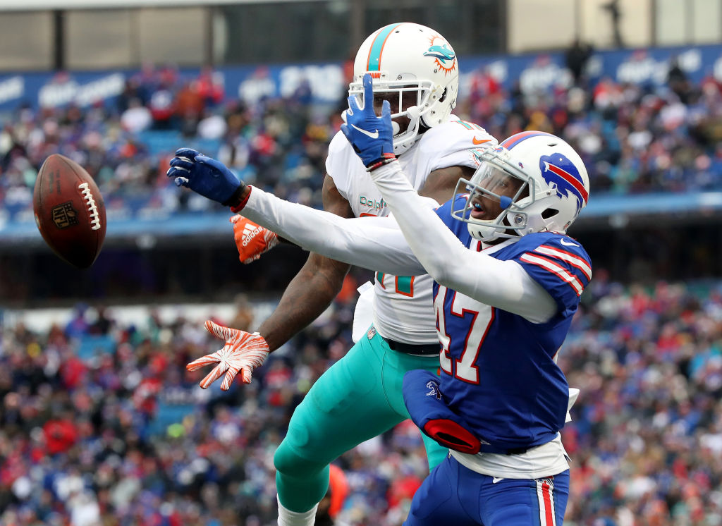 DeVante Parker #11 of the Miami Dolphins cannot catch a pass in the second quarter during NFL game action as Levi Wallace #47 of the Buffalo Bills defends at New Era Field on December 30, 2018 in Buffalo, New York. (Photo by Tom Szczerbowski/Getty Images)