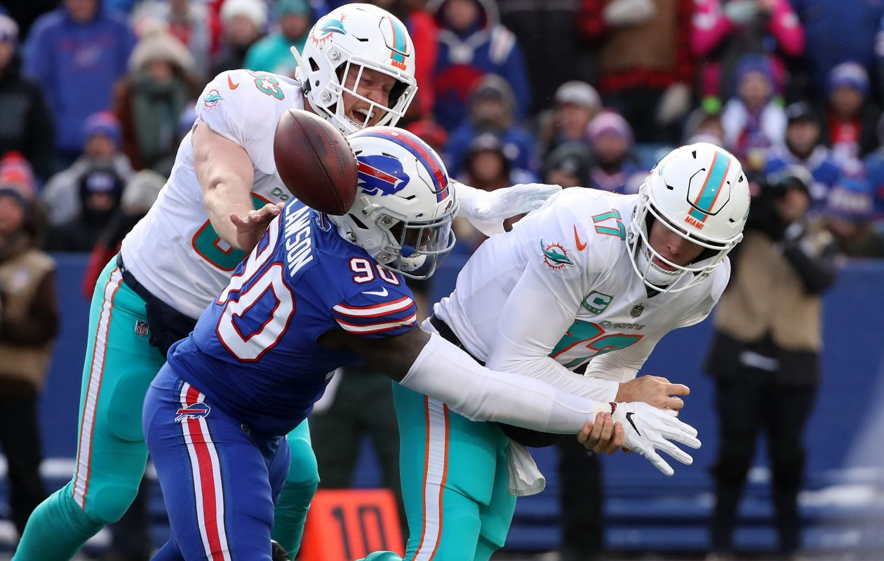 Bills defensive end Shaq Lawson makes one of his two sacks against Dolphins quarterback Ryan Tannehill in the season finale. (Getty Images)