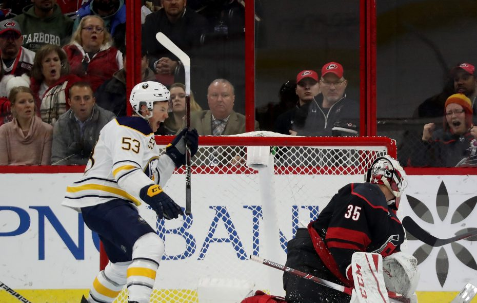 Jeff Skinner celebrates his first-period goal against Carolina's Curtis McElhinney Friday night  (Photo by Gregg Forwerck/NHLI via Getty Images).