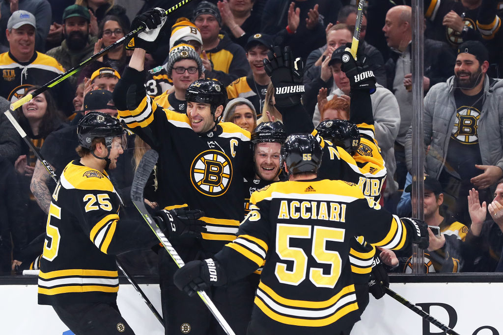 Bruins winger Chris Wagner celebrates with teammates after his first-period goal against the Sabres on Saturday in TD Garden. (Getty Images)