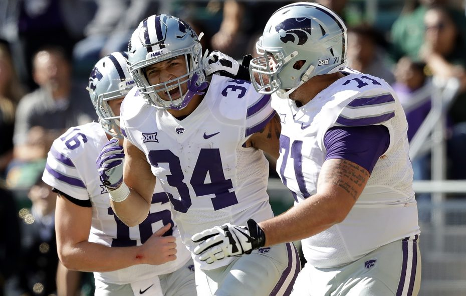 Dalton Risner (71) celebrates with Alex Barnes (34) after a Kansas State touchdown against Baylor in 2016. (Getty Images)
