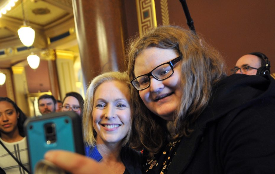 U.S. Sen. Kirsten Gillibrand takes a selfie with Kyla Paterson after speaking to a crowd Saturday for the third annual Women's March in Des Moines, Iowa. (Steve Pope/Getty Images)