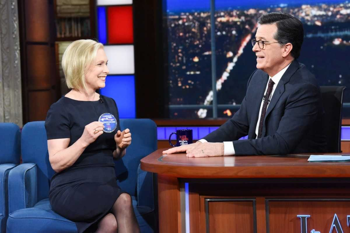 Sen. Kirsten E. Gillibrand displays a campaign button that Stephen Colbert handed her — which notes that she announced her presidential campaign on his show. (Scott Kowalchyk/CBS)