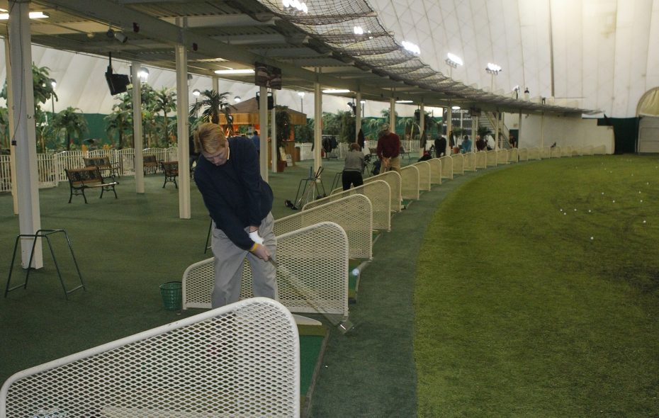 Larry Sams of Amherst works on a chip shot at  Paddock Chevrolet Golf Dome  in Tonawanda in 2013. (John Hickey / Buffalo News)