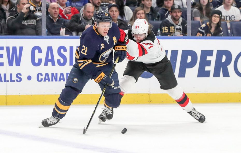 Kyle Okposo moves the puck past New Jersey's Pavel Zacha in the second period Tuesday night (James P. McCoy/Buffalo News).