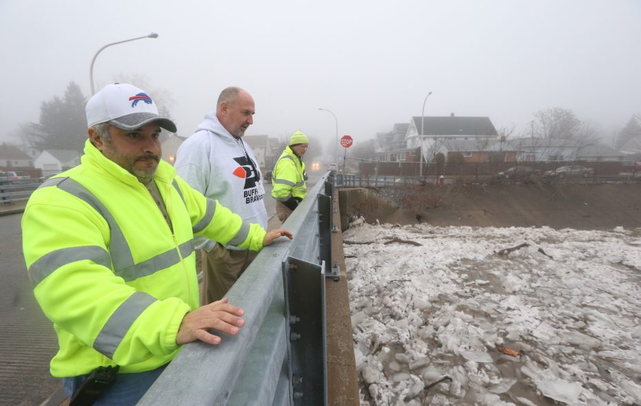 Buffalo Public Works Commissioner Steven Stepniak, center, inspects ice flows at the Stevenson Bridge on Cazenovia Creek during a 2017 flood warning. Stepniak is stepping down this week after 11 years in the job. (John Hickey/News file photo)