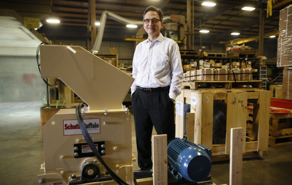 Martin Berardi, CEO of Schutte-Buffalo Hammermill, with one of the smaller hammermills his company makes at the Buffalo factory. (Derek Gee/Buffalo News file photo)