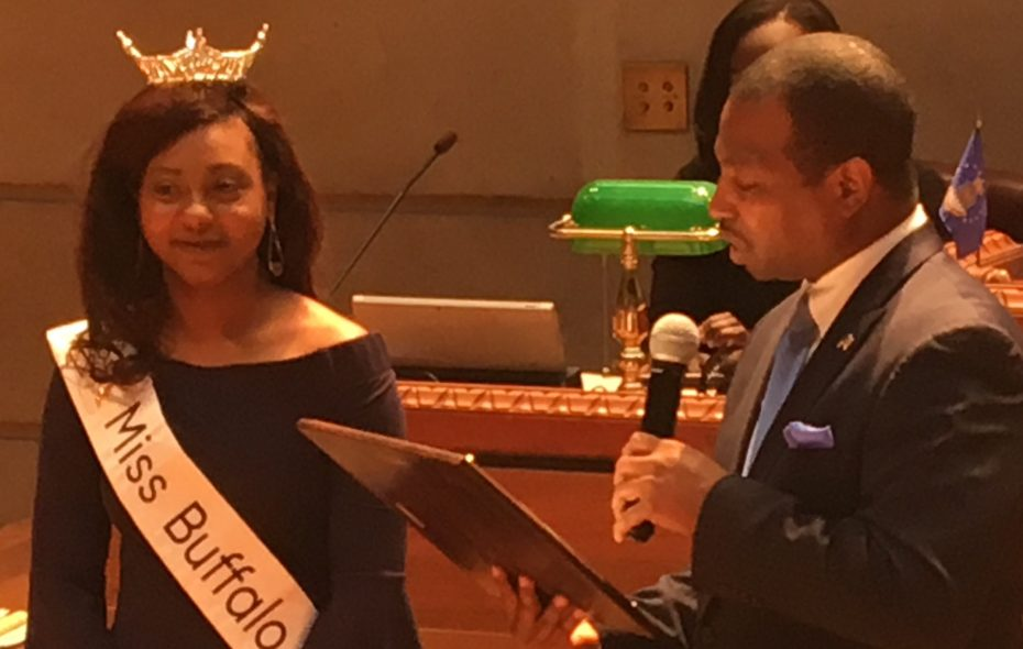 Taisha St. Jean, Miss Buffalo 2019, receives a proclamation from Common Council Member Rasheed N.C. Wyatt, who represents the University District, during Tuesday's Council meeting.  St. Jean is Wyatt's legislative assistant. (Photo by Deidre Williams)