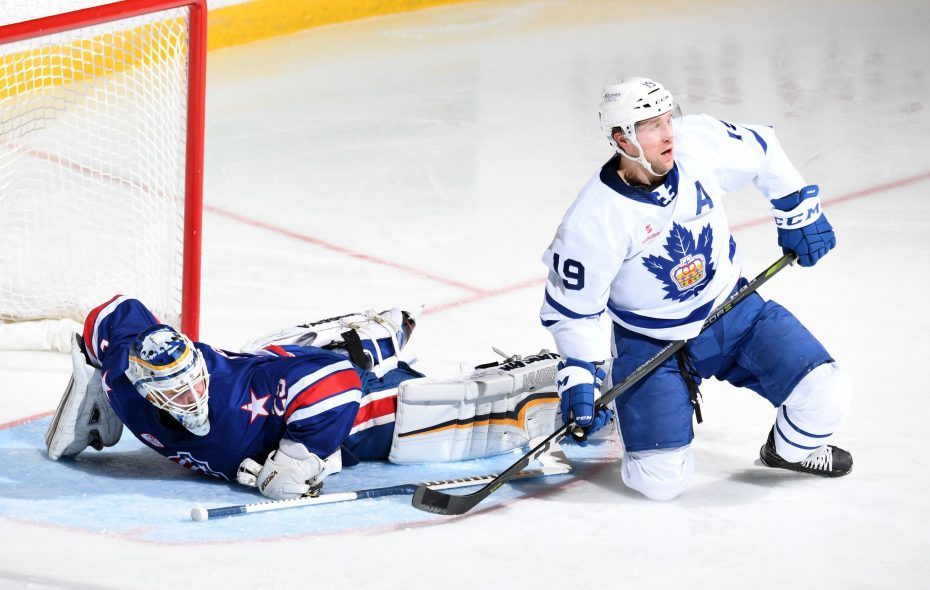 Marlies' Chris Mueller goes to the net on Amerks goalie Scott Wedgewood (Micheline Veluvolu/Rochester Americans)