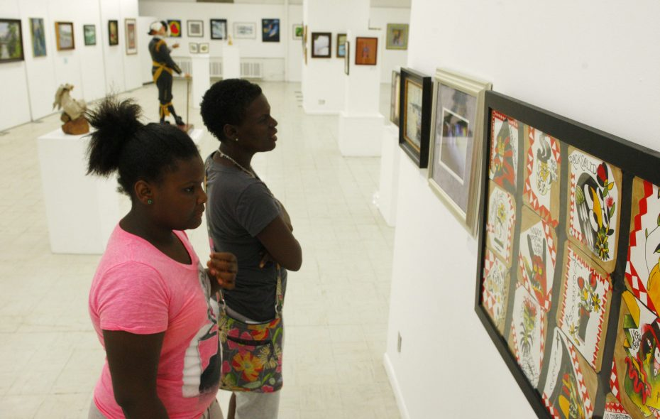 An art exhibit in the Niagara Arts and Cultural Center, like this one being viewed by Tiona Saunders and her daughter, Meginta Eppes in 2014, will be created by participants in a poverty reduction program in Niagara Falls. (Derek Gee/Buffalo News)