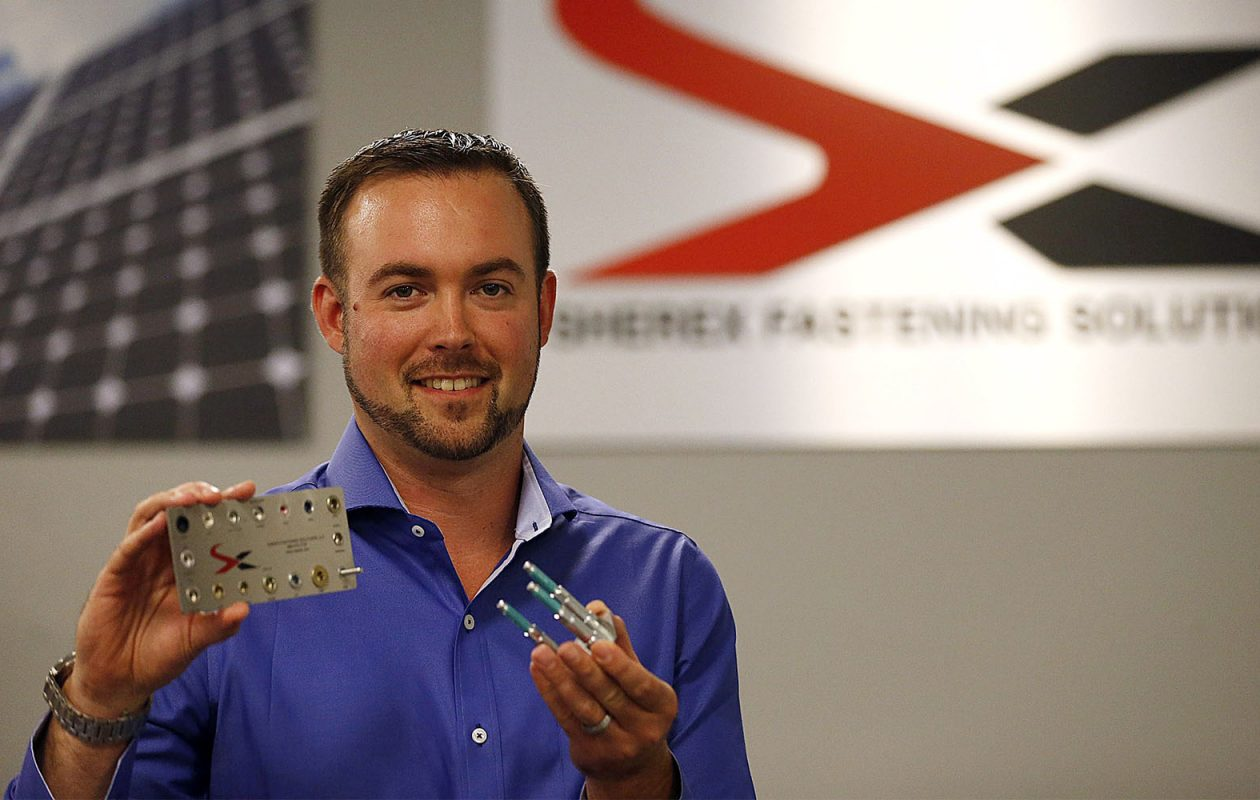 Sherex president Adam Pratt with some of their fasteners at their Tonawanda location on Tuesday, Aug. 12, 2014.  Sherex is a small manufacturer that is planning to use the services of the new Advanced Manufacturing Institute  (Robert Kirkham/Buffalo News)