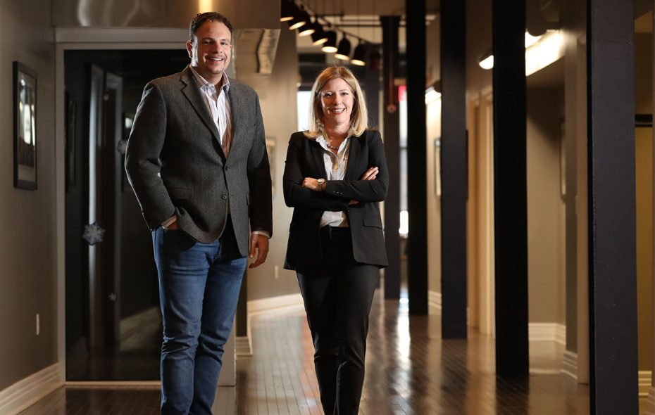 Nick Sinatra, left, president and founder of Sinatra & Co. Real Estate, with Amy Nagy, the company's director of development.   (Sharon Cantillon/Buffalo News)