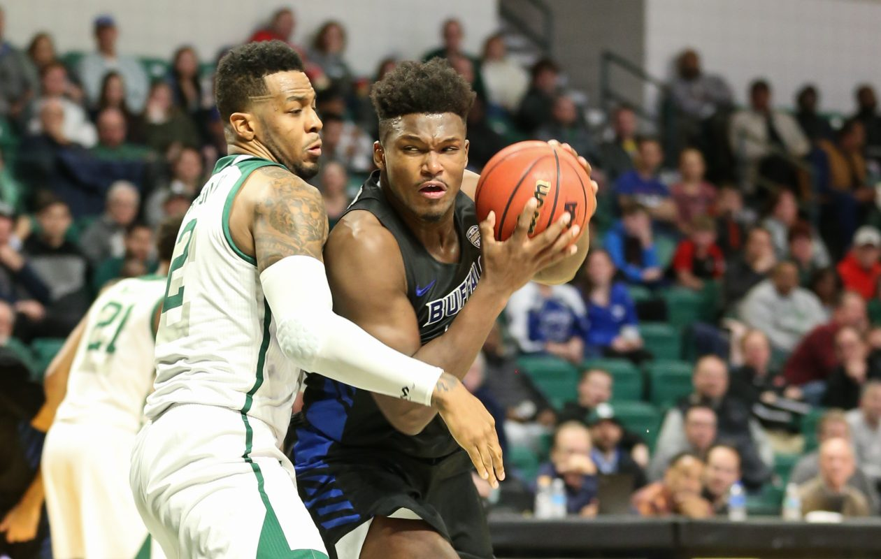 University of Buffalo forward Nick Perkins makes a move to the basket against Eastern Michigan Eagles forward James Thompson IV during the first half of the Bull's game against the Eastern Michigan Eagles at the Convocation Center in Ypsilanti, MI on January 4, 2019. (Photo by Scott W. Grau)