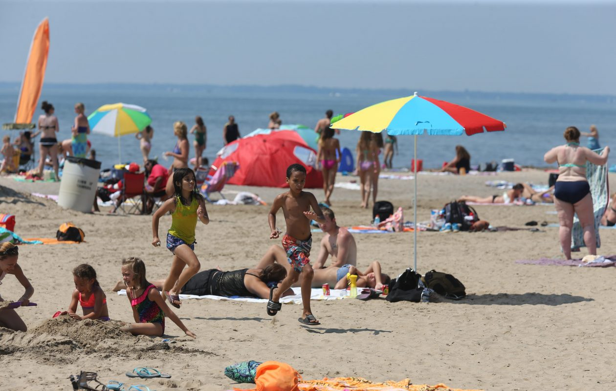 Hot weather led to a crowded beach at Woodlawn Beach State Park on a Tuesday in July, 2014. (Buffalo News file photo)