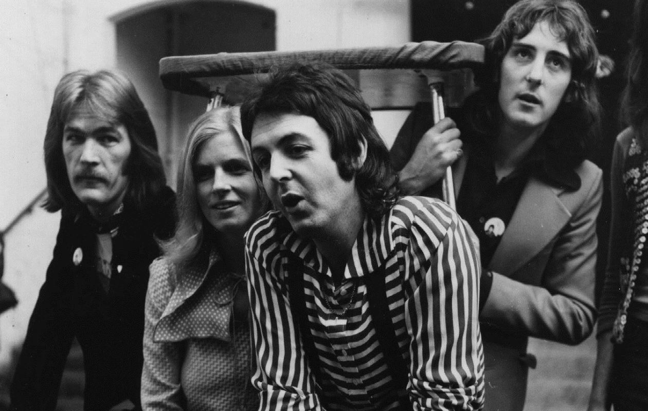 1972:  Paul and Linda (1941 - 1998) McCartney with members of Wings. Denny Laine, who comes to town on Jan. 16, is at right. (Photo by Evening Standard/Getty Images)