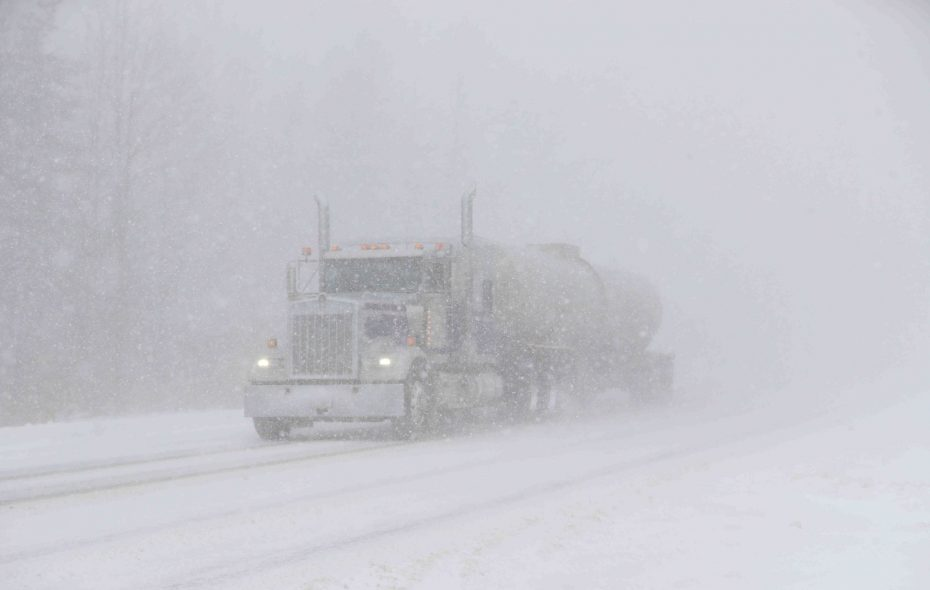 Vehicles in near white-out conditions on Route 20 and Gowans Road, in Angola on Friday. (John Hickey/Buffalo News)
