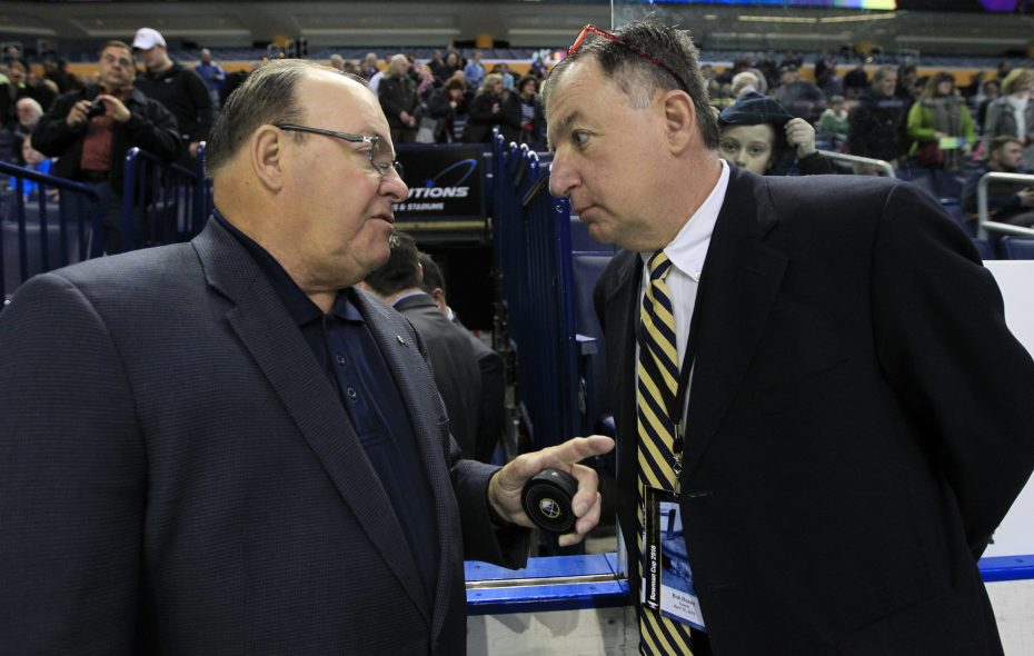 Bob Rosen, right, has spoken with NHL Hall of Fame coach Scotty Bowman many times during the annual Scotty Bowman Hockey Showcase. Rosen has guided Williamsville North to five state titles during his 29 seasons behind the bench and has been selected to coach in nine of the past 11 Scotty Bowman Hockey Showcases at KeyBank Center. (Harry Scull Jr./Buffalo News)
