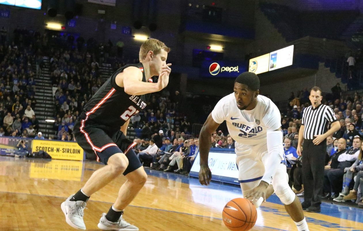 University at Buffalo guard Dontay Caruthers drives to the basket against Ball State guard Austin Nehls on Jan. 29 at Alumni Arena. (James P. McCoy/News file photo)