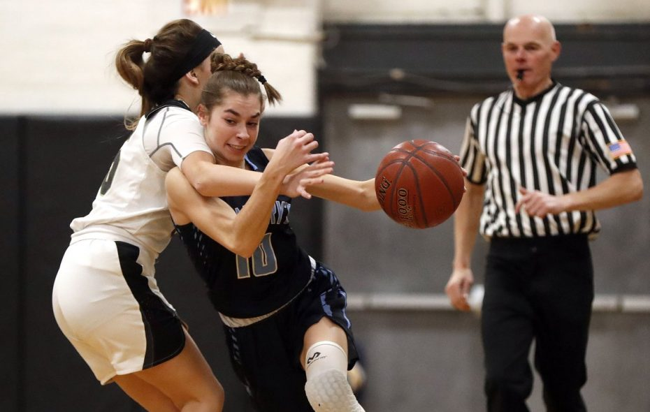 Cardinal O'Hara's Mia McCarthy tries to slow down St Mary's Shay Ciezki during Wednesday's game between Monsignor Martin Association contenders. (Mark Mulville/Buffalo News)