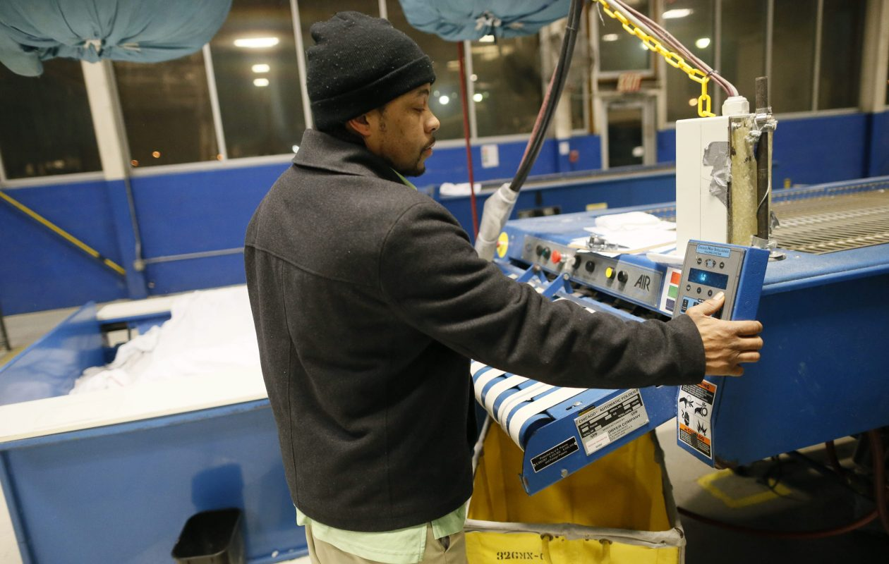 Curtis Flakes starts his 5:30 a.m. shift at Clarus Linen Systems. (Derek Gee/Buffalo News)