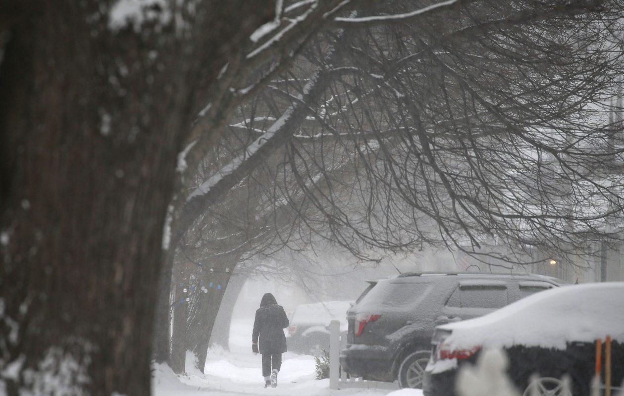 A pedestrian walks down Edgewood Avenue in Buffalo on Saturday. (Mark Mulville/Buffalo News)