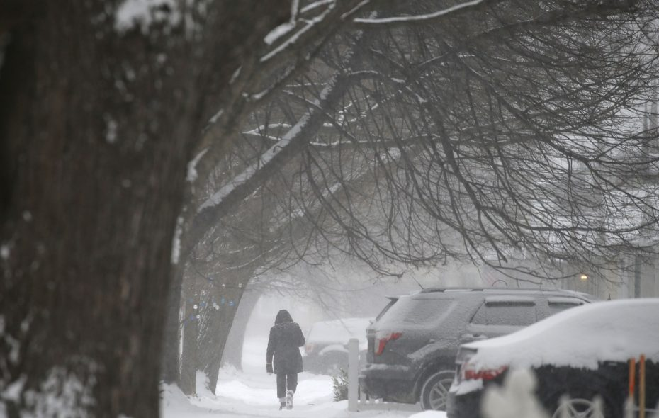 A pedestrian walks down Edgewood Avenue in Buffalo on Saturday. (Mark Mulville/Buffalo News)