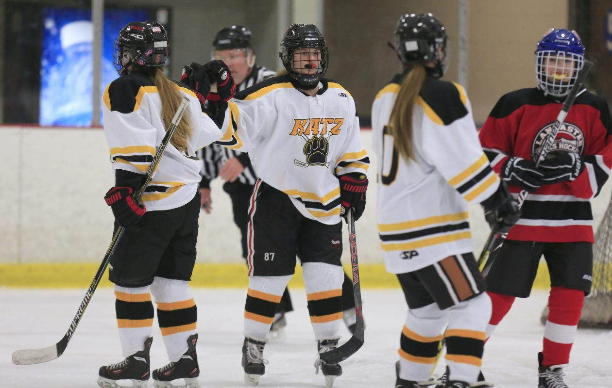 Amherst/Sweet Home/Clarence player Emma Faso is congratulated after a goal in 2016. (Harry Scull Jr./Buffalo News)