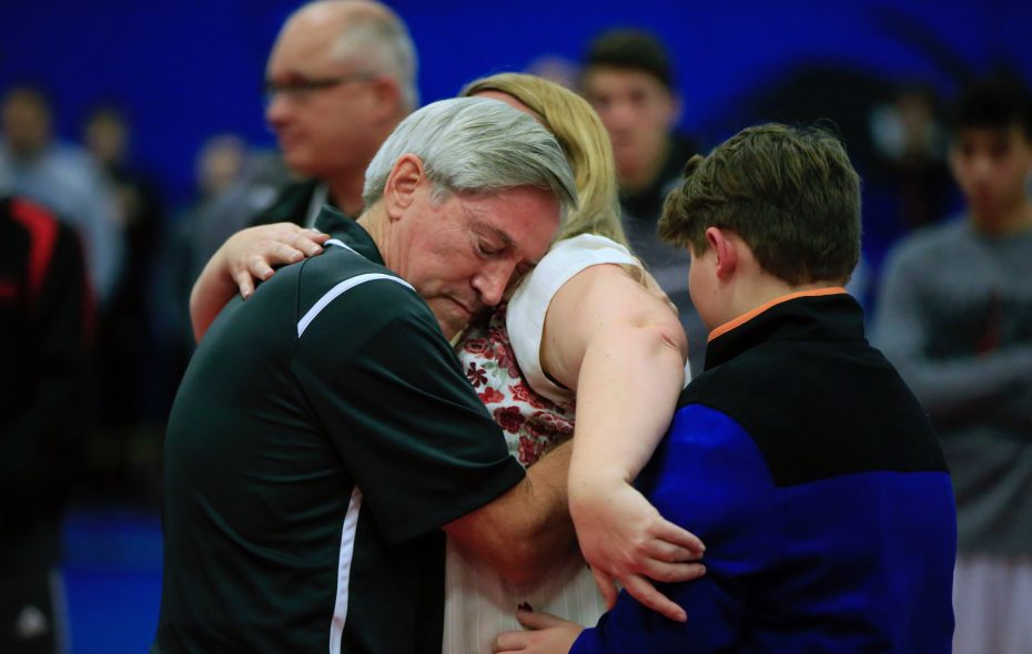 Phil Yoder hugs Kristin Clark after receiving the Linda Knuutila Memorial Award honoring Clark's late mother at the 38th Niagara Frontier Wrestling Officials Association Classic on Saturday, Jan. 5, 2019, at Niagara County Community College. (Harry Scull Jr./Buffalo News)