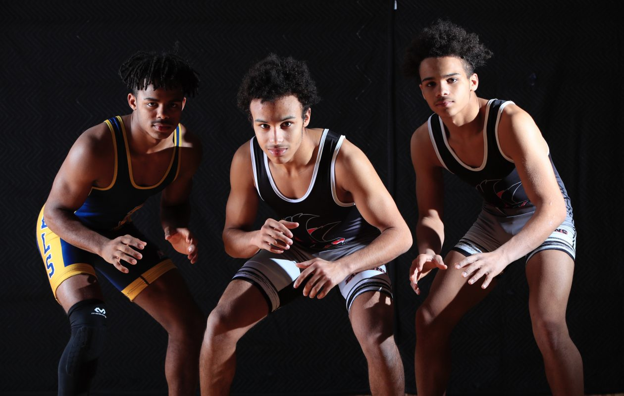 Left to right: Willie McDougald Jr. of Niagara Falls, Warren McDougald III of Niagara Wheatfield and his brother, Justin, are three of Western New York's top wrestlers. (Harry Scull Jr./Buffalo News)