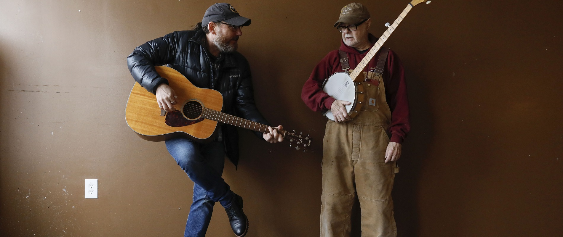Dave Ostrowski, left, known as 'Davey O,' and Mark Buell, owner of Nickel City Arts in Akron, have built a music series dubbed Nickel City Sessions. (Derek Gee/Buffalo News)