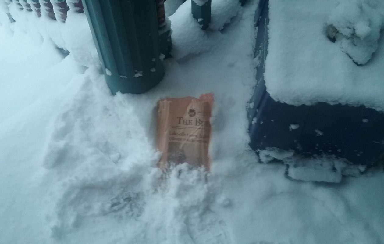 Buffalo News reporter Matt Glynn's newspaper was delivered to his home in Buffalo despite the snow Wednesday morning. (Matt Glynn/Buffalo News)