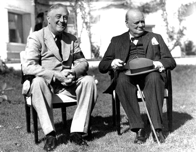 Franklin Roosevelt consults with British Prime Minister Winston Churchill, right, at the Casablanca Conference in 1943. (Roosevelt Library)