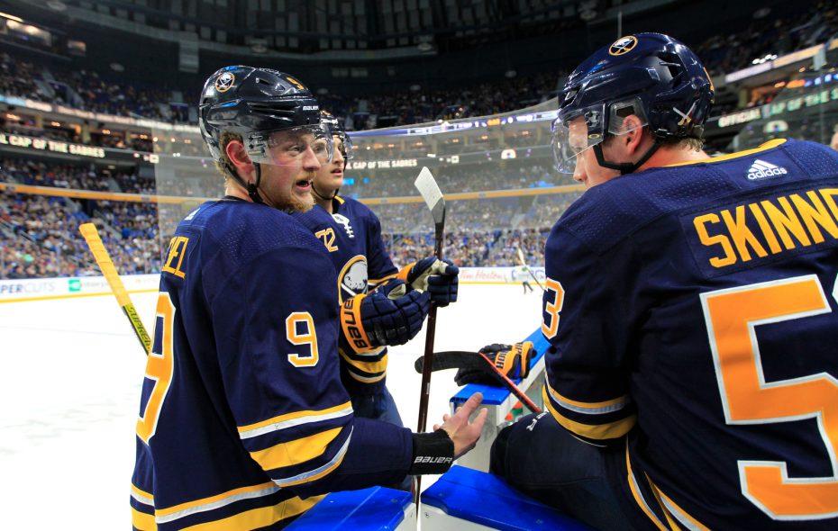 Buffalo Sabres' Jack Eichel talks with Jeff Skinner (Harry Scull Jr./ Buffalo News file photo)