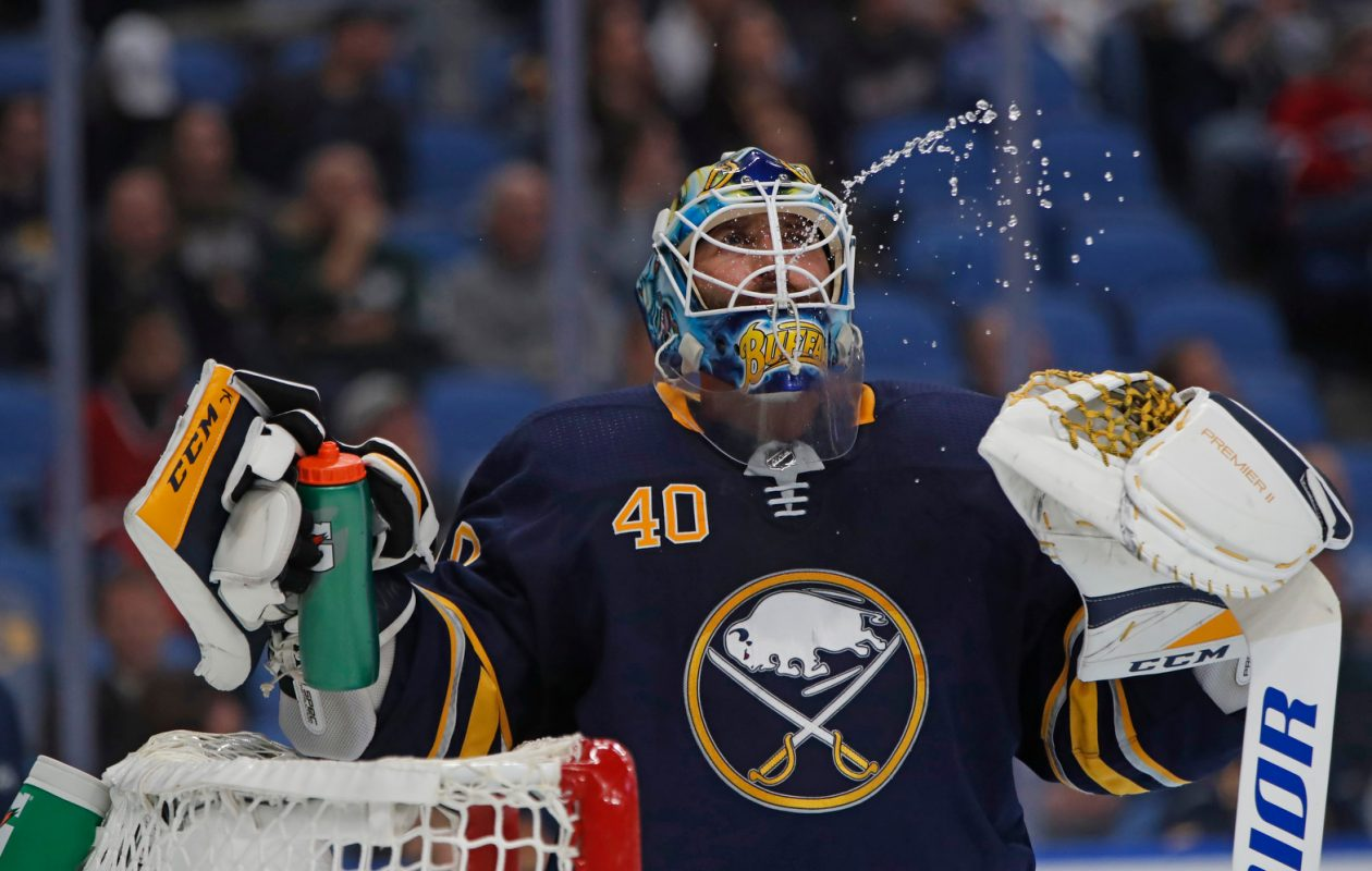 Buffalo Sabres goaltender Carter Hutton spits water during a break against the Montreal Canadiens during second period action at the KeyBank Center on Thursday, Oct. 25, 2018. (Harry Scull Jr./Buffalo News)