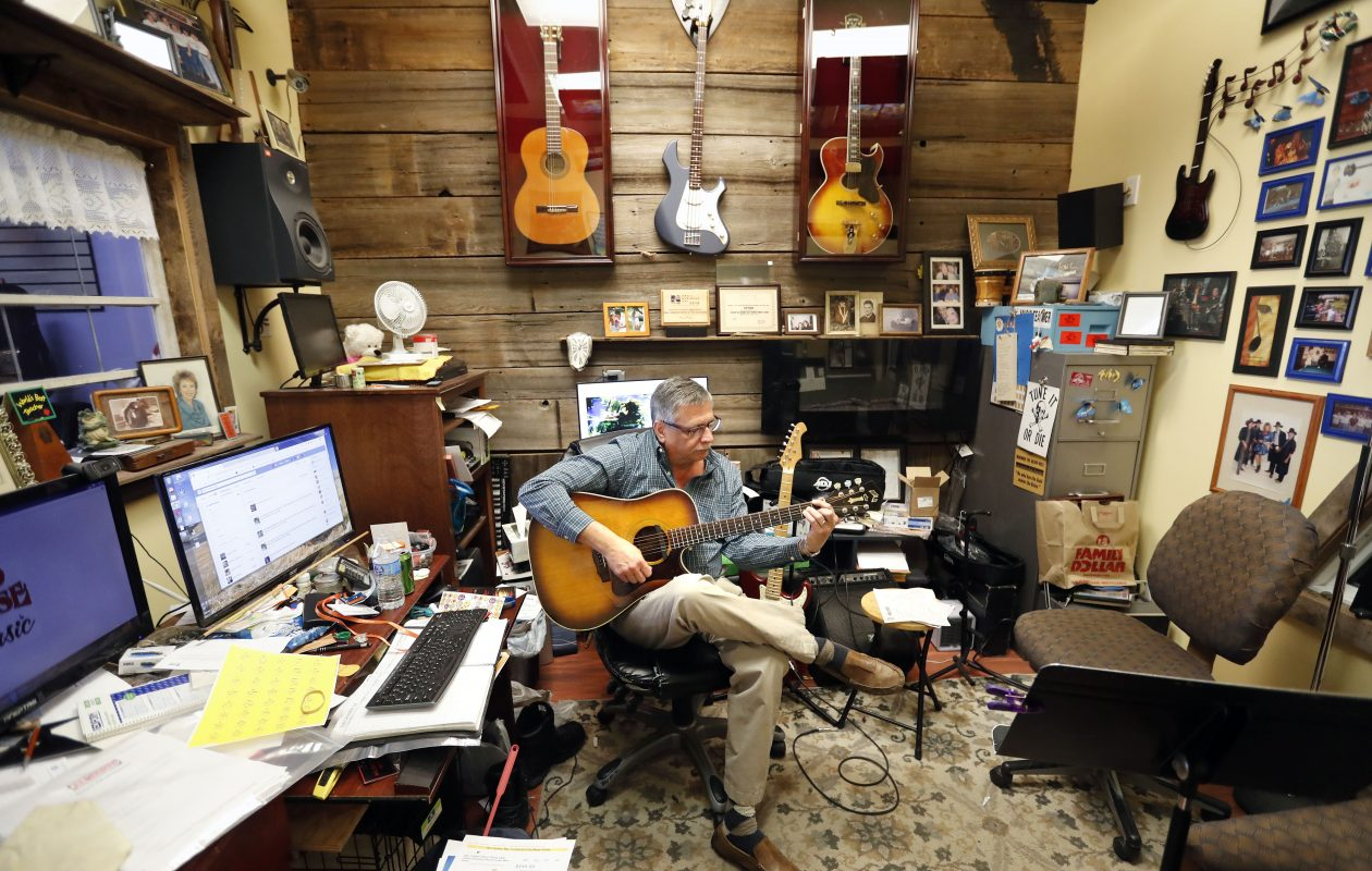 Eric Koch in his Red House Music Shop in Newfane: A protege, Patrick Harrington, has a shot at a Grammy. (Mark Mulville/Buffalo News)