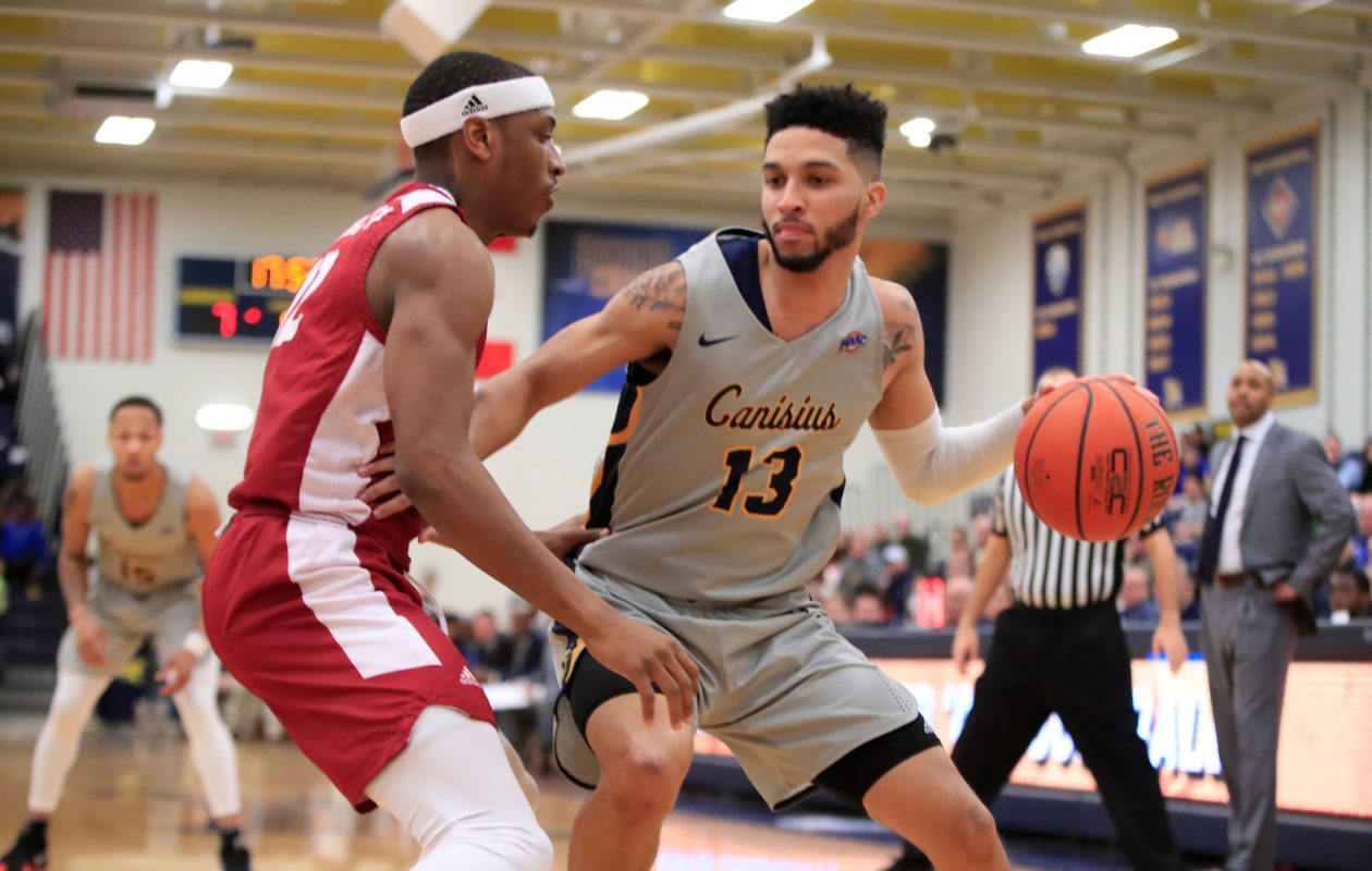 Canisius forward Isaiah Reese dribbles against Rider during the first half of a college basketball game at the Koessler Center. (Harry Scull Jr./News file photo)