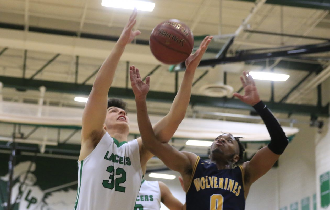 Joe Beatty of Lewiston-Porter and Niagara Falls Josiah Harris battle for a rebound during a January game between the teams. Both meet Thursday at Lockport High School for the Niagara Frontier League title at 7:45 p.m. (Harry Scull Jr./Buffalo News)