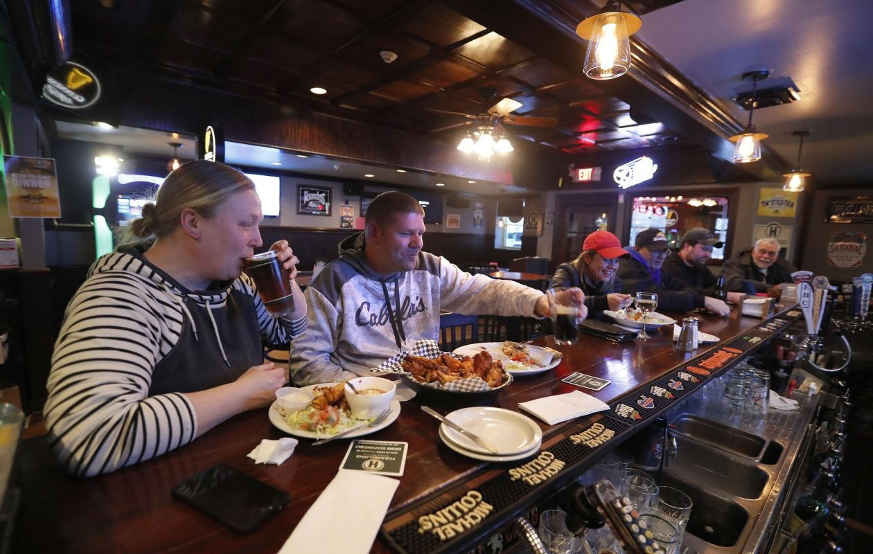 Erin Murtha, left, and Jeff Masterman enjoy some dinner at the bar of Eden Pub. (Mark Mulville/Buffalo News)