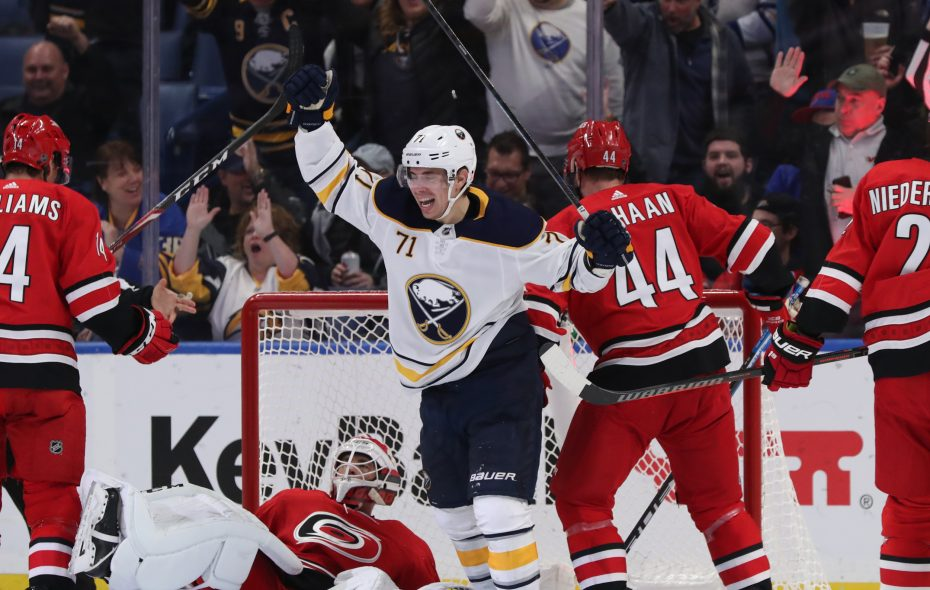 Evan Rodrigues, who had scored Buffalo's first goal, celebrates Jason Pominville's second-period tally against the Hurricanes. (James P. McCoy/Buffalo News)
