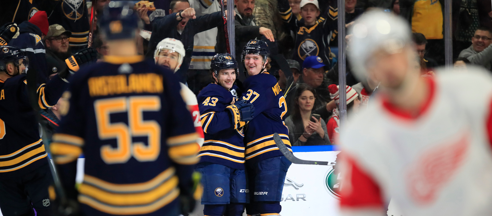 Buffalo Sabres forward Casey Mittelstadt congratulates Conor Sheary on his goal against the Detroit Red Wings during the second period at the KeyBank center on Saturday, Feb. 9, 2019. (Harry Scull Jr./Buffalo News)